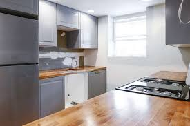 light grey kitchen cabinets with wood countertops diy wood countertop plans