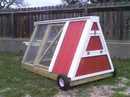 moveable chicken coop works like a wheelbarrow so you move the