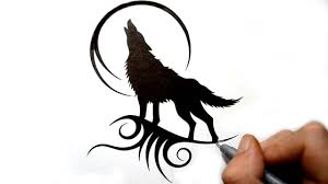 drawing a howling wolf silhouette black tribal tattoo design