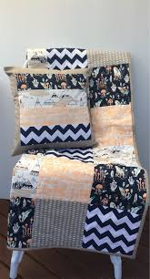 baby cot patchwork quilt w neutral colours and indian teepee