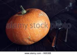 thanksgivings day pumpkin and candles stock photo royalty free
