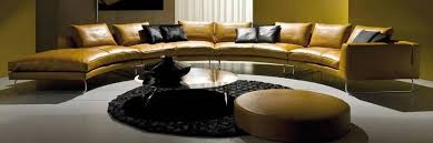 yellow leather sectional sofa with curved design with coffee table