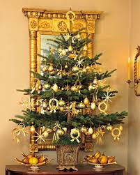 small tree with gold ornaments tis the season