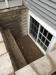 marvin divided lites double egress window in block well with step