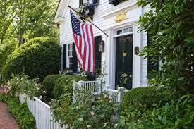 Massachusetts Travel Home images American flag hanging out in front of a white clapboard house with