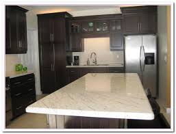 working on white granite countertop for luxury kitchen home and