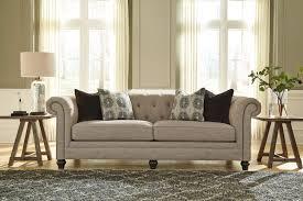 Ashley furniture tufted sofa