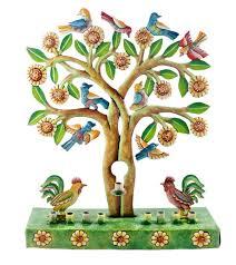 menorah tree of painted reycled metal menorah or chanukia of roosters in the grass