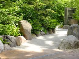 simple bamboo water feature in japanese garden in japanese garden