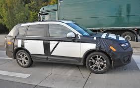 mitsubishi crossover 2015 mitsubishi outlander facelift spied in germany autoevolution