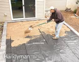 Laying Patio Slabs Concrete Patio Covered With Brick Pavers Renocompare