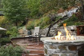 Slope For Paver Patio by Backyard Waterfall