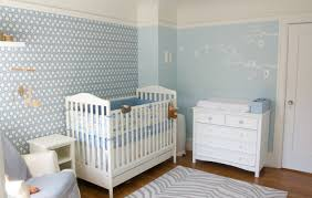 soft blue wall paint combined by white wooden cradle and drawer