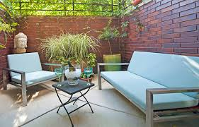 outside space cozy outside space featuring stainless furnishings by modernica