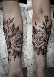 roses and rosary beads by bullseye tattoo artist victormodafferi