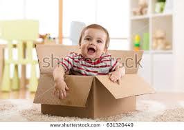 pretty baby infant boy sitting inside stock photo 631320449