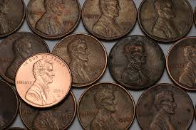 how can coins be cleaned and made shiny again