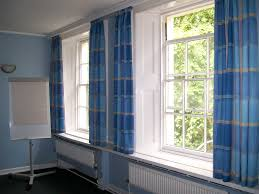 light tone wooden bench bay window with white curtain and blue