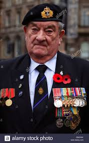 war veteran wearing his war medals at the remembrance day parade