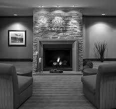 grey stone fireplace with grey wooden fireplace mantels and black