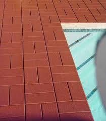rubber paving tiles can cover up unsightly cement around pools