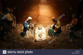 a model of the nativity scene with the baby jesus laying in a