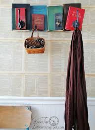 repurposed books into unique coat rack back to old