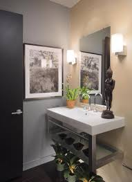 modern guest bathroom ideas with white floating sink using silver