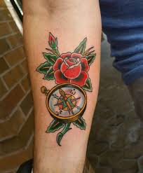 nautical compass and rose flower tattoo on forearm