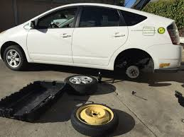how to change a flat tire a japanese auto repair inc