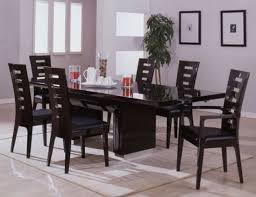 modern dining room chairs chosen for stylish and open dining area simple dark color for modern dining room chairs around long black table on grey carpet