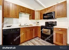 images of white kitchen cabinets with black appliances kitchen cabinets black appliances white tile stock photo