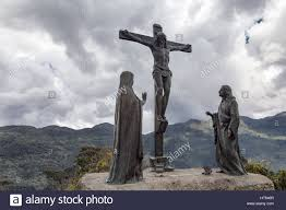 jesus statue with mountains in the background on monserrate in