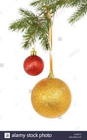 gold and glitter baubles hanging from a tree against
