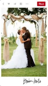 wedding arches decorated with burlap the log arbor with the flowers rustic and
