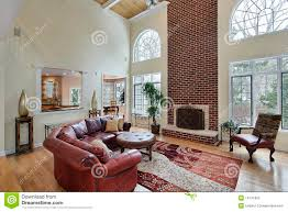 family room with two story brick fireplace stock photos image