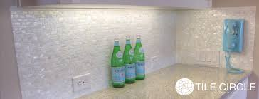 white square groutless mother of pearl tile home bar backsplash