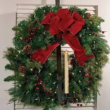 the door wreath hanger and candle holder ho ho ho