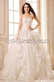 romantic ivory beaded sweetheart ruffled ball gown wedding dress