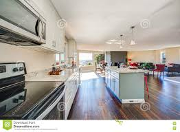 bright interior of kitchen with large kitchen island stock photo