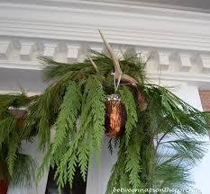 christmas front porch with three 3 boxwood wreaths deer head
