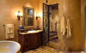 mediterranean bathroom with wrought iron door and vanity with