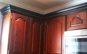 Kitchen Cabinet Trim Molding by Dark Stained Kitchen Cabinet Crown Molding Adding Tall Crown