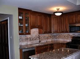 bronze brown wooden kitchen cabinet greyish granite counter top
