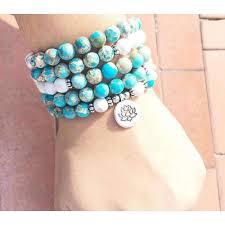 white bead bracelet images Blue and white bead stone mala bracelet lotus charm my zen temple jpg