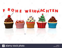 colorful cupcakes with german text frohe weihnachten