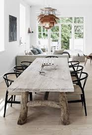 Distressed Wood Dining Room Table by Design Icons The Artichoke Pendant Wishbone Chair Wood Table