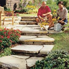 How To Make A Flagstone Patio With Sand How To Make A Path Of Building For A Stone Path Family Handyman