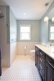 this white octagon mosaic floor tile bathroom