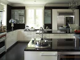 black and white kitchen cabinets dark granite countertops hgtv